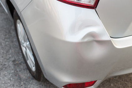Backside of new silver car get damaged by accident